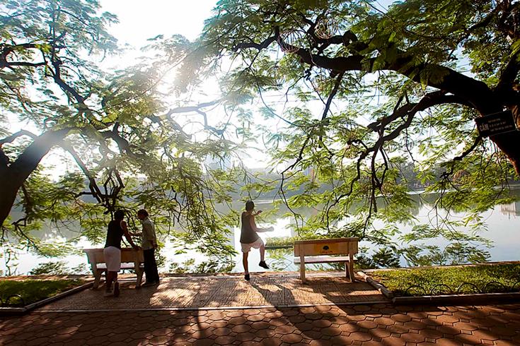 Doing morning exercise at Hoan Kiem Lake