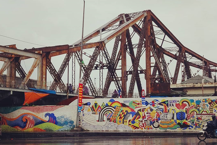 Long Bien bridge and the ceramic mosaic mural wall in the same frame