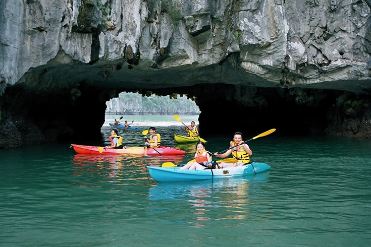 Dark and bright cave in Halong Bay