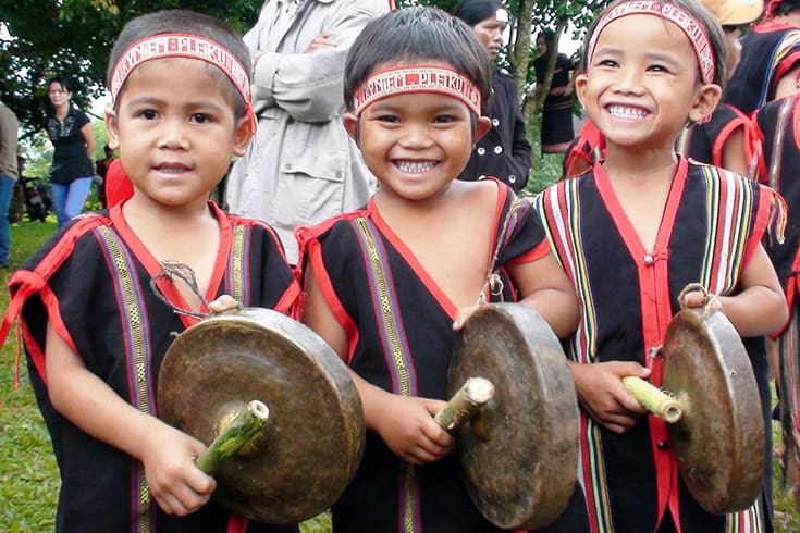 Culture value - Smile of ethnic group kids with gong