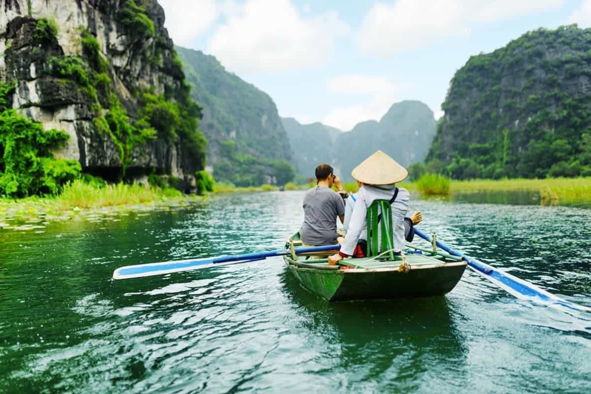 Take a boat ride in Trang An or Tam Coc