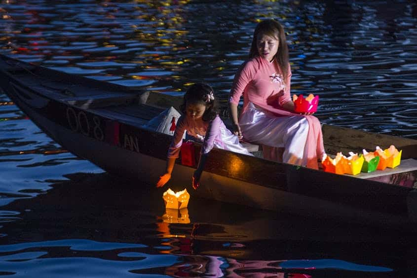Dropping Lanterns from a Boat - activities in Hoi An lantern festival