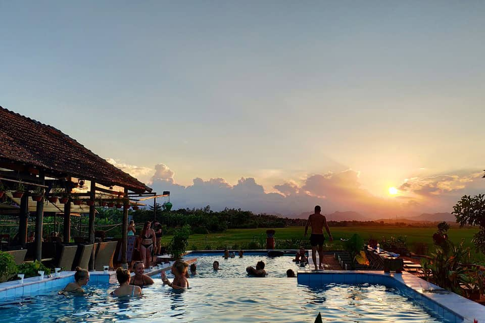 Sunset over the pool in Phong Nha farmstay - Duck massage in Quang Binh