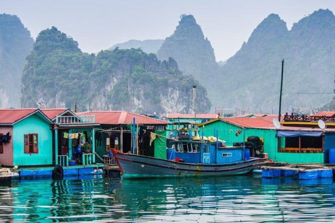 Visit Cua Van floating village near Dark and Light cave