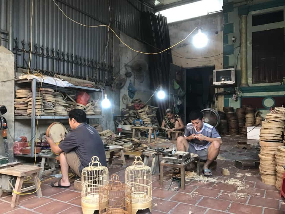 craftmen in Vac bird cage making village